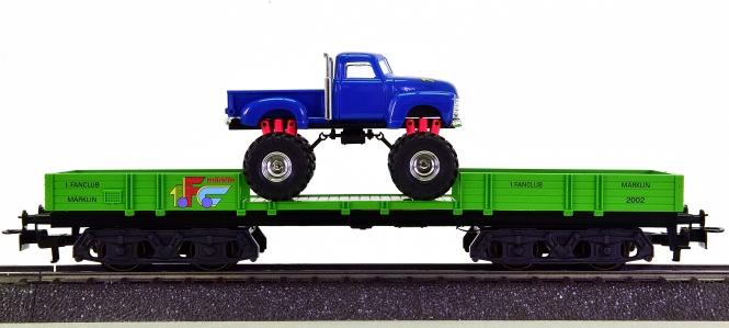 Märklin 44731 – Niederbordwagen Rlmms mit Monster Truck,  Jahreswagen 2002